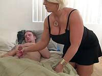 Busty Cougar Mom Wakes Boy Up With A Handjob