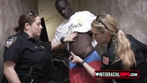 Big Breasted Cops Capture Suspect